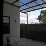 Patio roof installation - polycarbonate and steel
