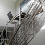 Scaffold again to hang the art
